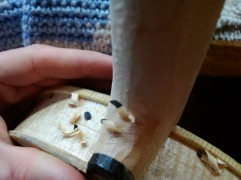 Working on the neck heel with a chisel. Being careful with the ebony crown!